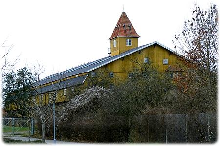 Plums Tømmerlade opført 1915 i Assens